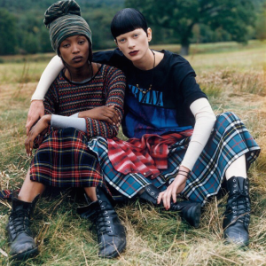 (Vogue) I love the use of flannel skirts with unfinished hems paired with thrifty combat boots graphic band shirts and dark lips.