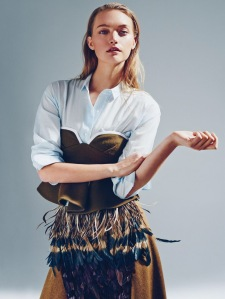(Unknown) A dramatic take on two of the biggest trends with feathered fringe and famine styled prep wear